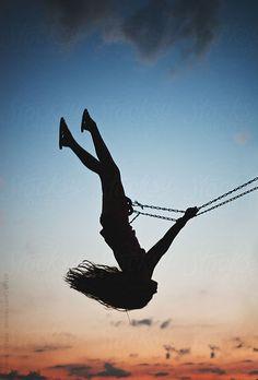 Swinging by Melanie DeFazio #stocksy #realstock