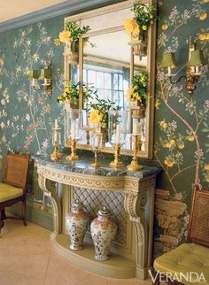 Splashes of citrus brighten the all over print of this dining room by Charlotte Moss.