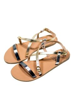 Ancient Greek Sandals uses centuries-old techniques to handcraft its luxe shoes. These metallic leather 'Sofia' sandals have crisscross straps and a comfortable rubber-trimmed heel. Wear yours on vacation with a breezy mini dress.   Sofia Sandals  by Ancient Greek Sandals. Shoes - Sandals - Flat Oklahoma