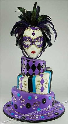 Masquerade cake...I don't like this mask but I think it would be fun to do a tipsy cake :)