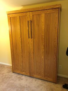 """Our customer from Morristown, New Jersey chose the Bedderway Queen Contemporary Face Murphy bed oak stained Golden Oak with 21"""" black contemporary handles."""