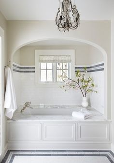 Lovely circular alcove making the bathtub a real focal point of the bathroom. #bathroom #bath #tiles