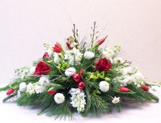 Flower Arrangements Centerpieces | centerpiece of christmas flowers and greenery makes a wonderful gift ...