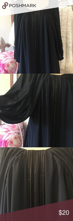 """Ark & Co. Chiffon Tunic w/chains Sz. Medium Ark & Co. black chiffon like fabric that is lined in size medium. Oversized and flowy and ties at the back. Front has small chains that hang loosely about 3/4 way down the front. It measures about 20"""" arm pit to arm pit and 35"""" shoulder to hem. Has big flowy sleeves. This is certainly a statement piece and looks so great with boots . Ark & Co Tops Tunics"""