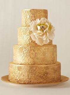Beautiful gold wedding cake - the design seems pressed on, like some sort of stencil! I kind of love it.
