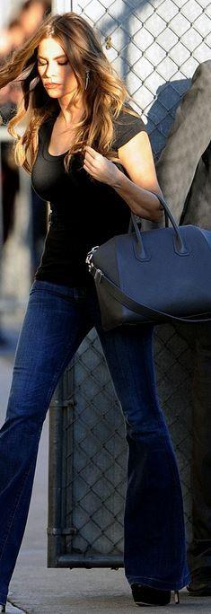 Who made  Sofía Vergara's black handbag and blue flared jeans?