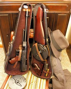 Tommy Gun in violin case.  The favorite of the gangster of the 20's.  I always loved reading the stories of the mobster in the 20's and there antic.  Now this is a fact,  the mobsters out gunned the Police Dept in those days.  They usually bought those Tommy Guns at their local hardware store.