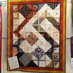 This quilt was hanging across from my booth. I thought it was the most unique log cabin I've ever seen. It's such a modern twist to such an old pattern. I couldn't help but think @missouriquiltco would love this. #quiltshow #quilting #logcabinquilt