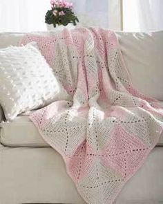 This is such a lovely and dainty crochet afghan pattern for you to put together. Girls will especially appreciate the white and rose motifs and eyelet design used to create this beautiful afghan. This crochet pattern is made with worsted weight yarn.