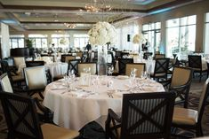 Elegant Ivory and Champagne Wedding Reception With Extra Tall White Hydrangea and Natural Branch Centerpiece in Wide Glass Vase with Gold Framed Table Number | Sarasota Wedding Venue Sarasota Yacht Club | Tampa Bay Wedding Planner NK Productions