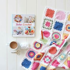 crochetdaily SO Lovely!  from @crochetbyredagape -  I'm working on the border today. I'll be doing many rounds of dcs (sc) and admiring this gorgeous book in my breaks  Mandyxx  #crochetcurio #crochet #afghan #grannysquare  #crochetersofinstagram