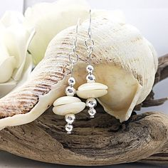 Speaking of beach days, have a little fun in the sun in these boho style puka shell earrings . Happy May Long Weekend, Canada! Shell Bracelet, Shell Earrings, Dangle Earrings, Shell Jewelry, Earrings Handmade, Handmade Jewelry, Unique Jewelry, Good Luck Gifts, Beach Bracelets