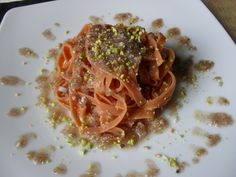 handmade red tagliolini with winey pistachios sauce
