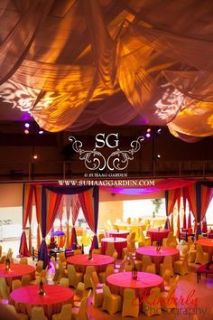 Suhaag Garden, Florida Indian wedding decorator, Mehndi, colorful drapery and linens, indoor cabanas