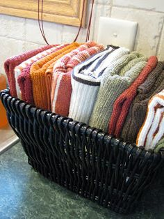 Dishcloths in a basket beside the sink...or under the sink. I like this idea better with wash clothes in a half bathroom that is used by visitors so your hands are clean after every hand wash instead of using the same hand towel in the bathroom. junk drawer, cleanses, hands, bathrooms, sinks, baskets, kitchen, dish towels, hand towels