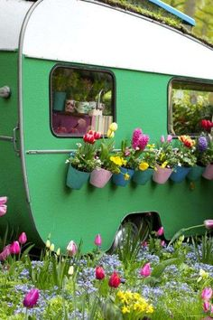 turning an old green camper into a planter
