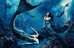 """by Annie Leibovitz.   """"Where another world is just a wish away"""" with Julianne Moore as Ariel and Michael Phelps as a Merman"""