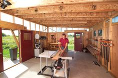 DIY Shed - everything about this woodworking shop...windows, double doors, storage (needs more), and ALL those CLAMPS!