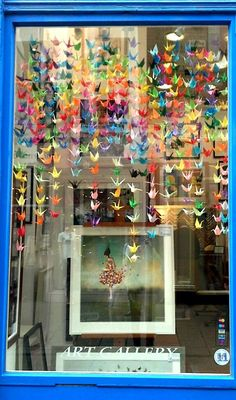 We made these origami birds for our shop window display.