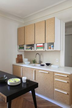 Not crazy about the chipboard, but I do like the idea of dropping a shelf below the cabinet to make room for cookbook storage.