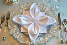 Fold a snowflake napkin!