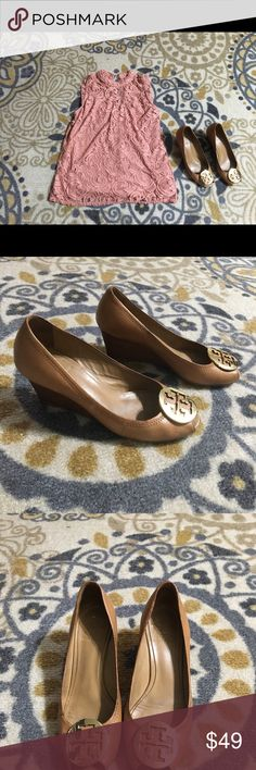 Tory Burch camel peep toe wedges Sooo cute & comfortable. Have been worn many times but still wearable condition. Only selling because my feet seem to have gotten bigger. 😕 Not broken down at all. Just a little heel/toe wear as shown in pics. Some darkening of leather in inconspicuous (when worn) spots. Very classy. Wear is not visible when wearing. Tory Burch Shoes Wedges