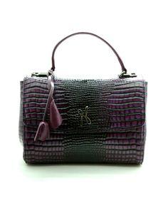 Sac à main Luxembourg  Ce sac à la fois pratique et élégant est idéal pour apporter une touche glamour à toutes tenues. Il est à la fois structuré et très souple, et permet également de garder les mains libres grâce à sa bandoulière, ce qui le rend très pratique pour un usage quotidien.