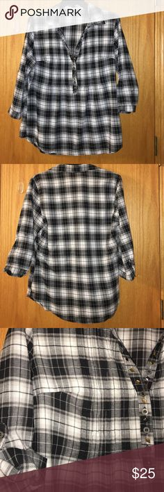 """Maurice's lightweight embellished plaid blouse Maurice's loose fitted and lightweight black & white plaid blouse embellished with metal diamond shapes. Metal pieces and buttons look like antique brass with some patina and green flecks in the finish. Buttons up halfway, leaving a collared v-neck. Vertical pleats through chest area and side bust darts. About 23""""across chest and 28"""" from shoulder to hem (2"""" longer in back). 3/4 sleeves have button tabs inside for rolling up or making gathered…"""