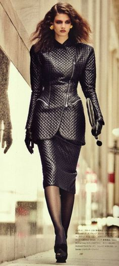 Quilted black leather skirt and jacket ensemble runway fashion