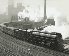 Google Image Result for http://chuckmanchicagonostalgia.files.wordpress.com/2012/03/photo-chicago-train-chicago-and-north-western-e4-type-locomotive-pulling-passenger-train.jpg