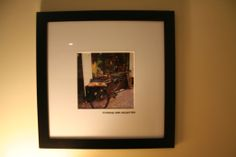 """Our framed travel photo hanging in the Wisteria suite- """"Amsterdam beer delivery bike""""- The Wisteria Suite is a 400 s.f. self-contained suite with private entrance. Lounge area has: a sofabed (converts from sofa to Queen bed with a memory foam topper), 2 tub chairs cozy electric heated fireplace, flat-screen TV, DVD, kitchenette with dining table and microwave. French doors open to a private Queen bedroom with en-suite bathroom (shower only). Buffet breakfast is served in the common guest…"""
