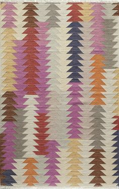 Stacked triangles of sorbet colored hues creates an arrow graphic on our Shawnee Rug.
