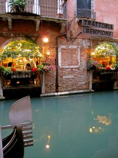 "Canal side cafe ""Trattoria Sempione"" in Venice_ Italy"
