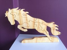 Unique design, leaping horse puzzle, this is a free standing puzzle, and would be a great gift for any person who loves horses, puzzles, or just loves the design. Can be a gift for a child or adult. It is made from pine, and can be finished with tung oil or left natural. This was