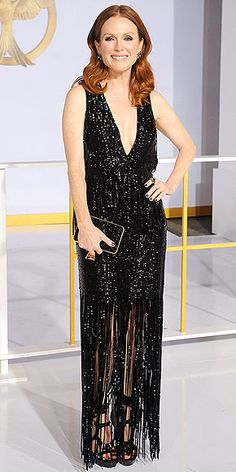 JULIANNE MOORE We love it when stars give us red carpets whiplash within days, and Julianne's dark fringed Tom Ford at The Hunger Games: Mockingjay – Part 1 L.A. premiere is about as far as you can get from the winter white she wore to the Hollywood Film Awards last week.