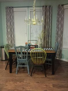 Wall color waterscape by Sherwin Williams.  Mismatched painted chairs.  Yellow painted chandelier.