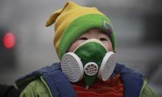 Heavy-duty face masks are now frequently seen on Beijing's streets. - Provided by Guardian News