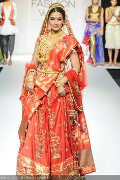 Sonali Bendre walks the ramp for Harshitaa Chatterjee Deshpande on Day 3 of the Lakme Fashion Week (LFW) Winter/Festive 2013, held at Grand Hyatt, Mumbai, on August 24, 2013.