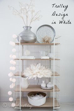 A baker's chest or a trolley decorated with a white boho beach theme.