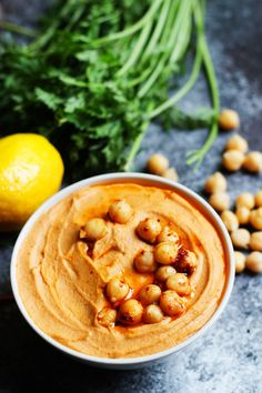 This Harissa Hummus is smoky, spicy and tangy. A perfect party dip!   platingsandpairings.com