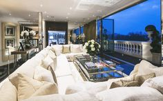 Living room with a white couch in Tom Cruise's London Penthouse // Interior Designer Paul Davies