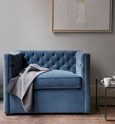 blue velvet tufted chair