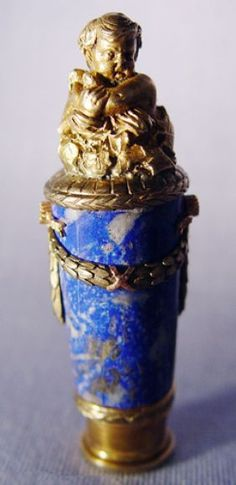 Faberge Lapis Lazuli, Diamond, and Silver Seal with Gold Foliate Swags and Bezel Set Diamonds