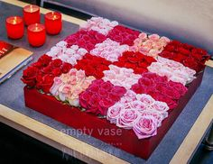 Bed of Roses   An avant-garde interpretation of the traditional red rose, this arresting contemporary arrangement contrasts the soft, ruffled swirls of 90 lush roses with striking geometric design. In such extraordinary numbers, these beautiful flowers overwhelm the senses.