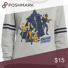 STAR WARS CLASSIC ATHLETIC SWEATSHIRT There's nothing more classic than Star Wars. This beloved franchise is featured on a classic athletic style pullover. This grey and navy crewneck features an old school Star Wars character logo to give you a look that's 100% authentic.  Officially licensed by Her Universe 50% cotton; 50% polyester Wash cold; dry low Star Wars Tops Sweatshirts & Hoodies