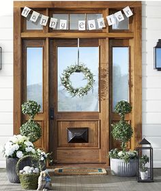 Make your Easter guests feel special the moment they reach your doorstep. Set a welcoming scene with a cheery banner, beautiful topiaries and a chic spring wreath to complete the look. Happy Easter Banner, Front Door Decor, Front Doors, Front Porch, Door Entry, Easter Crafts, Easter Ideas, Easter Decor, Holiday Fun