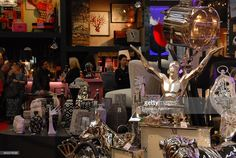 Guests view products including handmade works souvenirs and consumer goods during 'Ambiente 2015...