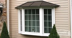 White three-lite bay window with colonial grids and shingled hip roof. Learn more. Bay Window Exterior, Bay Window Living Room, Front Yard Patio, Vinyl Replacement Windows, Pergola Plans, Pergola Ideas, Pergola Kits, Colonial Style Homes, Hip Roof