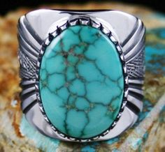 Leonard Nez Rare Gem Grade Cheyenne Spiderweb Turquoise Ring #LeonardNez Cheyenne is a small hat claim in central Nevada that has produced a small number of gem grade turquoise cabochons. This fine natural example is a lovely teal blue with complex gold spiderweb matrix. It is set in a hand made bezel atop a heavy ten gauge shank. Leonard has deeply incised and textured the band of the piece to add to the beauty of the ring. Rare and collectible, it is striking and substantial on the finger.