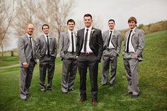 Groomsmen in light gray suits, groom in dark charcoal -- love it